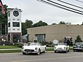 Murray Family Memorial Plazza Clock Tower and cars and municiple building.jpg
