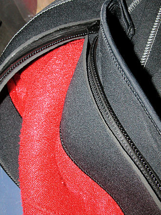 Wetsuit - Detail showing zipper attachment, internal flap and cover flap of semi-dry suit