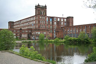 Heywood, Greater Manchester - Following the Industrial Revolution, Heywood became a mill town, its landscape dominated by large brick-built cotton mills. This one is part of the Grade II listed Mutual Mills complex.