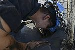 Nimitz Airman calls out to Sailors working in arresting gear 151020-N-CE703-081.jpg