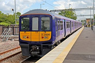 Huyton railway station - A Northern Electrics Class 319 at the newly reopened platform 3, in 2015.
