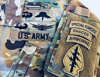 Badges of the United States Army - Example of badges and tabs worn on the U.S. Army Operational Camouflage Pattern (OCP) uniform