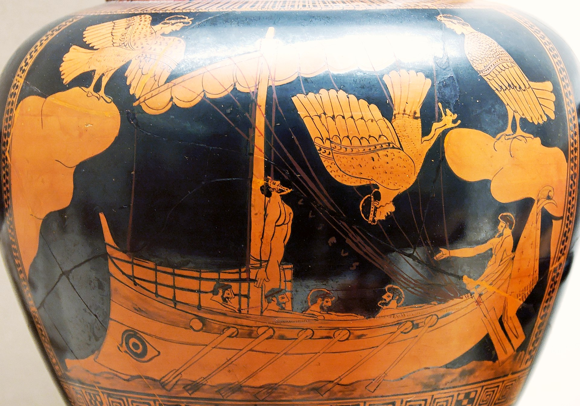 Black figure vase painting of Odysseus and the Sirens, eponymous vase of the Siren Painter, c. 480–470 BC, (British Museum). A man on a ship, tied to the mast. Birds with the heads of women swoop at him. His rowers are unperturbed as they have their ears plugged with wax.