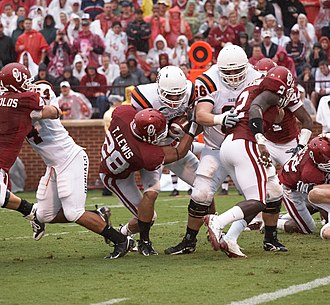 2009 Oklahoma Sooners football team - Travis Lewis tackles a Bengal ball carrier.