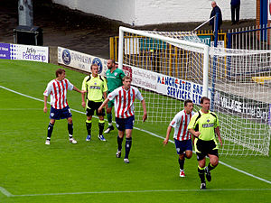 Oldham Athletic A.F.C. - Oldham Athletic (in yellow) in a friendly match against Bury during the 2009–10 season