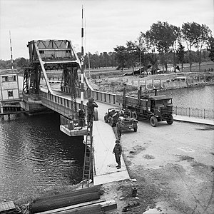 Oxfordshire and Buckinghamshire Light Infantry - Transport moving across the Caen Canal Bridge at Benouville, June 1944. The bridge was renamed Pegasus Bridge after the mythical winged horse on the formation sign of British airborne forces