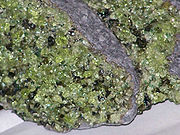 Peridotite xenoliths in basalt--olivines are light green crystals. Location: San Carlos Indian Reservation, Gila Co., Arizona, USA.