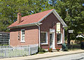 Photograph of a Small Brick Store on Main Street in Ste Genevieve MO.jpg
