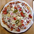 Pizza ready for the oven (17104956860).jpg