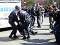 Police encounter a protester during the Olympic torch relay through Paris.jpg