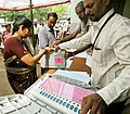 Polling officials collecting the Electronic Voting Machine (EVM) and other necessary belongings for use in the General Elections-2014, at the distribution centre, in Visakhapatnam, Andhra Pradesh on May 06, 2014.jpg