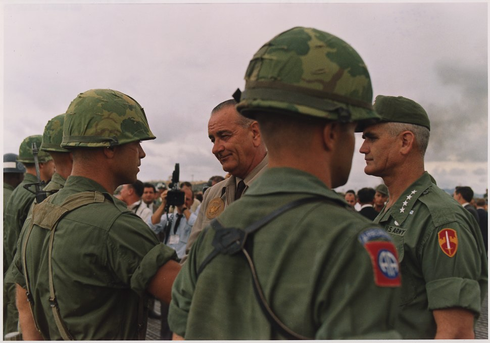 President Lyndon B. Johnson in Vietnam, With General William Westmoreland decorating a soldier - NARA - 192511