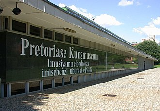 Afrikaans - The side view of the Pretoria Art Museum in Arcadia, Pretoria, with an Afrikaans language sign.