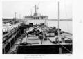 Queensland State Archives 4934 Backloading Cattle Transport Boat LST Weewak Cairns 1953.png