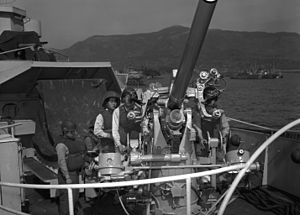 USS Rockford (PF-48) - South Korean sailors at their battle stations aboard the Korean frigate Amnokgang (PF 62) on a 3-inch gun, mounted on the forecastle of the ship.