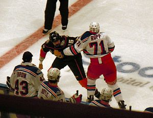 George Parros - George Parros with the Ducks in 2011 fighting the Rangers' Mike Rupp.