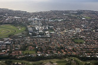 Randwick, New South Wales - Aerial view looking east over Randwick. Coogee (top), University of New South Wales (centre) and Royal Randwick Racecourse (left)