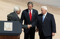Mahmoud Abbas, United States President George W. Bush, and Israeli Prime Minister Ariel Sharon after reading statement to the press during the closing moments of the Red Sea Summit in Aqaba, Jordan, June 4, 2003