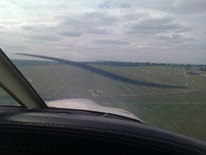 Redhill Aerodrome - About to land on runway 26L in a Piper Cherokee