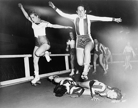 Two women's league roller derby skaters leap over two who have fallen in a March 1950 bout in New York City Roller Derby 1950.jpg