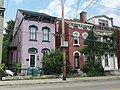Rowhouses with pig statue in yard (4763133126).jpg