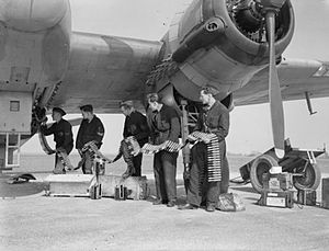 Bristol Beaufighter - Ground crew in the process of loading ammunition for the cannons of an RAF Beaufighter Mk VI night fighter