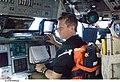 S125-E-006522 - Gregory C. Johnson on the flight deck of Atlantis during STS-125.jpg