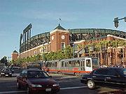 A Muni light rail passes AT&T Park, home of the San Francisco Giants.