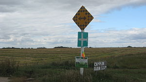 Traffic sign - Two or more signs may be displayed on one post. Here a Canadian end-of-road marker appears together with a rural airport sign.