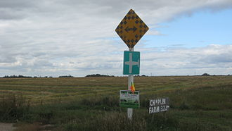 Traffic sign - 5 or more signs may be displayed on one post. Here a Canadian end-of-road marker appears together with a rural airport sign.