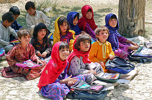 Education - School children sitting in the shade of an orchard in Bamozai, near Gardez, Paktya Province, Afghanistan
