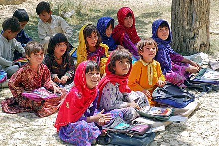 School children sitting in the shade of an orchard in Bamozai, near Gardez, Paktya Province, Afghanistan Schoolgirls in Bamozai.JPG