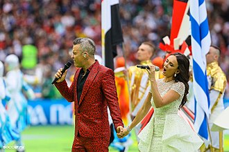 "Angels (Robbie Williams song) - Williams and Russian soprano Aida Garifullina performing ""Angels"" at the 2018 FIFA World Cup opening ceremony in Moscow, Russia"