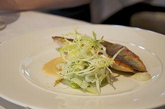 Pétrus (restaurant) - A sea bass main course dish served at Pétrus