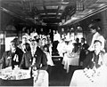Seattle Chamber of Commerce guests seated in the dining car of the North Bank Railroad enroute to Eastern Washington, September (WASTATE 1476).jpeg