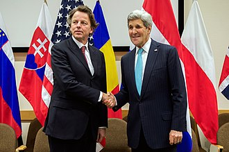 Bert Koenders - Minister of Foreign Affairs Bert Koenders and  United States Secretary of State John Kerry at a NATO summit in Brussels on 2 December 2014.