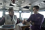 Secretary of Energy Rick Perry, left, discusses Hurricane Irma with Capt. Nicholas Dienna, commanding officer of the USS Harry S. Truman. (36934476702).jpg