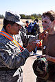 Senior Master Sgt.Tony Navarro applying makeup to CAP cadet.jpg