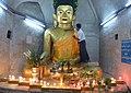 Shitthaung temple interior - gold leaf laying on Buddha.jpg