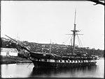Single masted passenger vessel near shore (3093478429).jpg