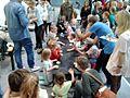 Smaki Regionow 2014, Poznan, MTP, Children bake bread.jpg
