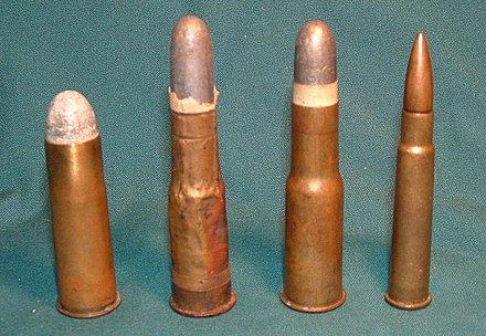 (From Left to Right): A .577 Snider cartridge (1867), a .577/450 Martini-Henry cartridge (1871), a later drawn brass .577/450 Martini-Henry cartridge, and a .303 British Mk VII SAA Ball cartridge. Snider-Martini-Enfield Cartridges.JPG