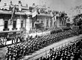 Soldiers and sailors from many countries are lined up in front of the Allies Headquarters Building HD-SN-99-02014.jpg