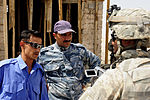 Soldiers visit Iraqi police during micro-grant survey DVIDS199995.jpg