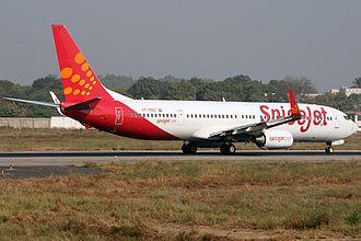 Sardar Vallabhbhai Patel International Airport - A SpiceJet Boeing 737-900ER on the runway