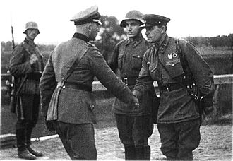 War crimes in occupied Poland during World War II - German and Soviet army officers pictured shaking hands; Invasion of Poland, September 1939