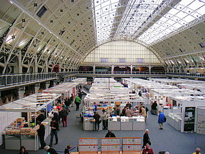 Stamp collecting - A large stamp show containing a bourse at which collectors and dealers meet.