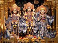 Rama (center) with wife Sita (right), brother Lakshmana (left standing) and devotee Hanuman (left, bottom).