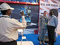 Staff Sgt. Marlena Coverston gets her photo taken with a visitor at the Aero India 09 air show.JPG