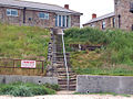 Steps from the small beach beside the harbour, Seahouses - geograph.org.uk - 1379474.jpg